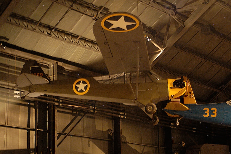 "Piper L-4 ""Grasshopper"" in the World War II Gallery at the National Museum of the United States Air Force. (U.S. Air Force photo)"