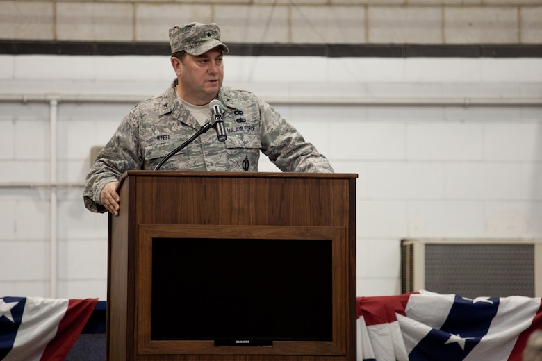 Brig. Gen. Gary W. Keefe, Massachusetts Air National Guard Commander, speaks to members of the 212th Engineering Installation Squadron and their families at Otis Air National Guard Base, Mass. on March 21, 2014. Members of the 212th will be deploying in support of Operation Enduring Freedom from late March to late November. (National Guard photo by Staff Sgt Jeremy Bowcock/Released)