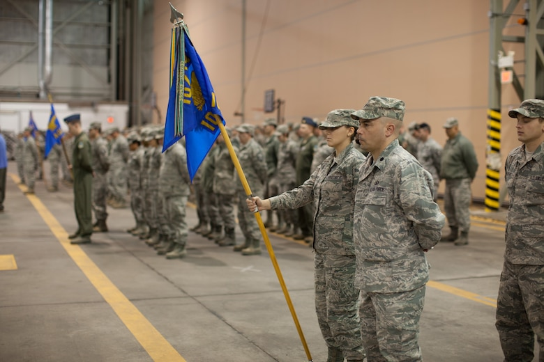Members and family of the 102nd Intelligence Wing gather to say to their farewells to 31 members of the 212th Engineering Installation Squadron on Otis Air National Guard Base, Mass. on March 21, 2014. Members of the 212th will be deploying in support of Operation Enduring Freedom from late March to late November. (National Guard photo by Staff Sgt Jeremy Bowcock/Released)