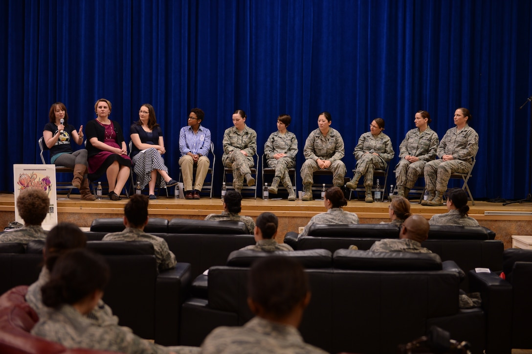 Women of all ranks and statuses participate in a panel discussion in celebration of Women's History Month March 20, 2014, at the Brick House at Spangdahlem Air Base, Germany. The panel event gave base members the opportunity to speak to influential women in the community. After the discussion ended, a social hour allowed for candid conversation with panel members. (U.S. Air Force photo by Senior Airman Alexis Siekert/Released)