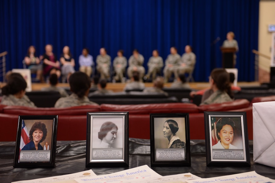 Photos of historically influential women are displayed during a Women's History Month event March 20, 2014, at the Brick House at Spangdahlem Air Base, Germany. The informal environment allowed for open communication between audience and panel members. Some of the topics discussed included mentorship, inspiration, challenges, changes and the future. (U.S. Air Force photo by Senior Airman Alexis Siekert/Released)