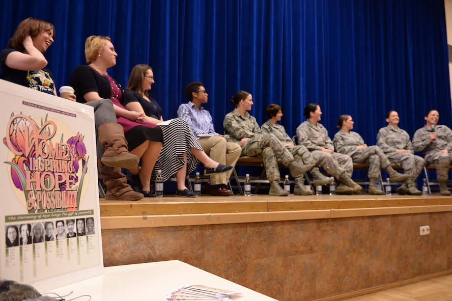 Ten women nominated to speak in a Women's History Month event share a laugh at the Brick House March 20, 2014, at Spangdahlem Air Base, Germany. The event was titled Women Inspiring Hope and Possibility. These women accepted the position of panel members after being nominated in a base-wide search for influential women in the Spangdahlem community. (U.S. Air Force photo by Senior Airman Alexis Siekert/Released)
