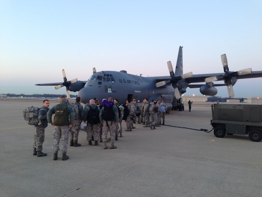 Members of the 175th Civil Engineer Squadron, Maryland Air National Guard prepare to board a C-130 Hercules on the way to Ramstein Air Base Germany to participate in the Silver Flag exercise, March 21, 2014, Warfield Air National Guard Base, Md. The Silver Flag exercise simulates training relevant to building and beddown of a bare base operation in a deployed environment. (U.S. Air National Guard photo by Master Sgt. Gareth Buckland/Released)