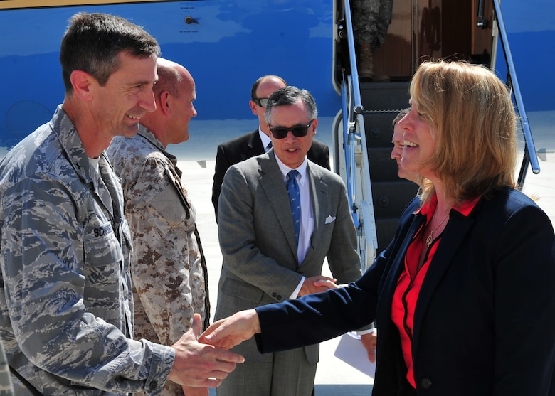 Brig. Gen. Kevin Schneider greets Secretary of the Air Force Deborah Lee James March 19, 2014, at an undisclosed location in Southwest Asia. The secretary visited the base to learn more about the mission of the 380 Air Expeditionary Wing and meet with Airmen. Schneider is the 380th AEW commander. (U.S. Air Force photo/Staff Sgt. Michael Means)