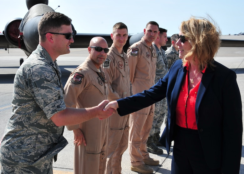 Secretary of the Air Force Deborah Lee James greets Airmen during a flight line tour at the 380th Air Expeditionary Wing March 19, 2014, at an undisclosed location in Southwest Asia. During her visit James held an all call, speaking on three priorities: Taking care of people, balancing today's readiness with tomorrow's readiness and making every dollar count. (U.S. Air Force photo/Staff Sgt. Michael Means)