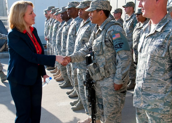 Secretary of the Air Force Deborah Lee James greets Airmen during a walking tour at the 380th Air Expeditionary Wing March 19, 2014, at an undisclosed location in Southwest Asia. During her visit James held an all call, speaking on three priorities: Taking care of people, balancing today's readiness with tomorrow's readiness and making every dollar count. (U.S. Air Force photo/Staff Sgt. Michael Means)