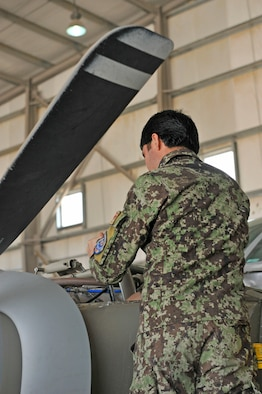 An Afghan aviation maintenance student works on a Cessna 208 engine during training at Shindand Airfield, Afghanistan, March 9, 2014. U.S. military advisors are training Afghan military members to fly and maintain aircraft at Shindand.(U.S. Air Force photo by Senior Master Sgt. Gary J. Rihn)