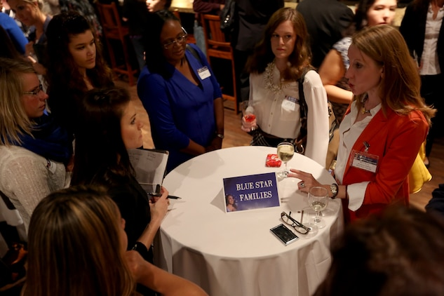 Military wives converse with a representative from Blue Star Families about job opportunities during the Hiring Our Heroes Networking Reception at the Pacific Views Event Center, March 25. The reception was held in order to obtain more knowledge about career planning.