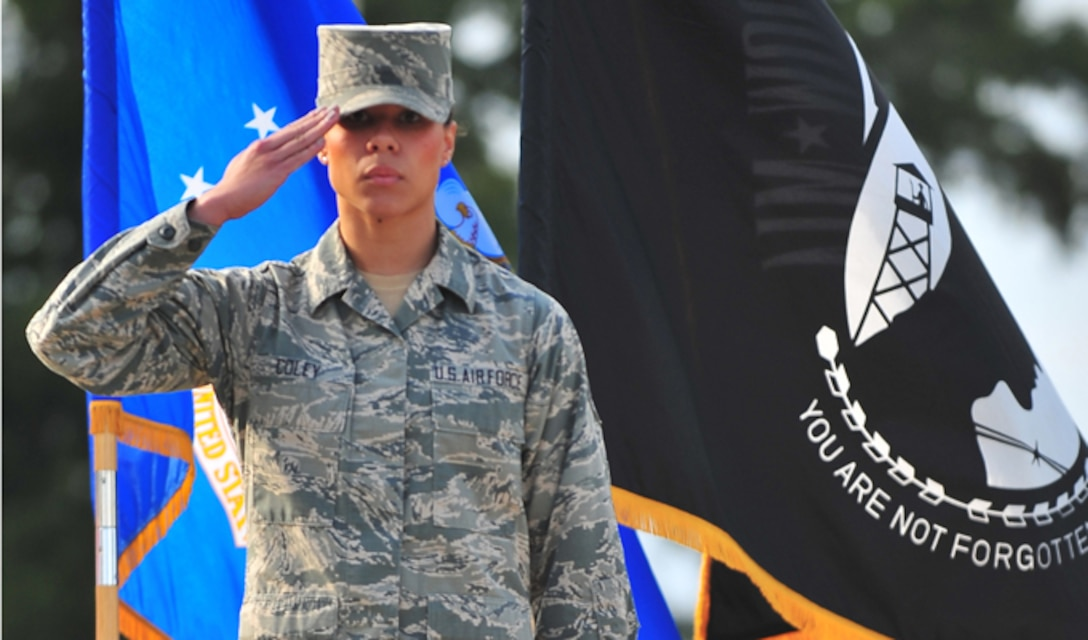 Senior Airman Amber Coley renders a salute as the U.S. military Code of Conduct is recited during the 4th Fighter Wing Prisoner of War/Missing in Action ceremony Sept. 20, 2013, at Seymour Johnson Air Force Base, N.C. The Code of Conduct, in six articles, addresses basic information useful to POWs when captured by hostile forces. Coley is 4th Medical Operations Squadron physical therapy technician. (U.S. Air Force photo/Senior Airman Aubrey White)