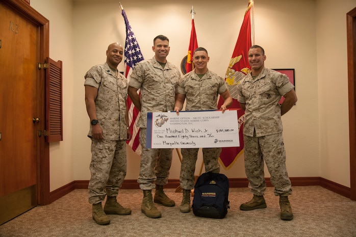 Cpl. Michael Wick is awarded the Naval Reserve Officers Training Corps scholarship valued at $180,000 at 12MCD headquarters, Marine Corps Recruit Depot, San Diego, March 24.