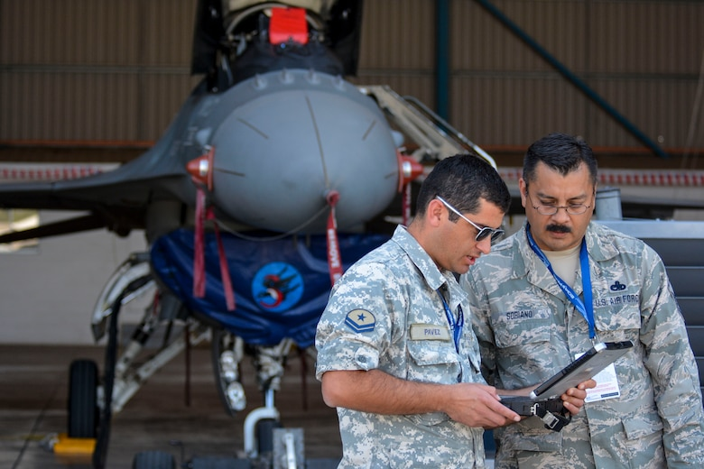 Master Sgt. Pedro Soriano, an F-16 maintenance specialist from the Texas Air National Guard, talks with a counterpart from the Chilean air force about working with the F-16 during the first day of the FIDAE Air Show in Santiago, Chile, March 25. Nearly 60 U.S. airmen are participating in subject matter expert exchanges with Chilean air force counterparts during FIDAE, and as part of the events will host static displays of the C-130 Hercules and F-16 Fighting Falcon. The exchanges, conducted regularly throughout the year, involve U.S. Airmen sharing best practices and procedures to build partnerships and promote interoperability with partner-nations throughout South America, Central America and the Caribbean. (U.S. Air Force photo by Capt. Justin Brockhoff/Released)