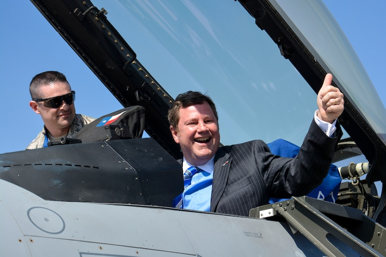 Michael Hammer, U.S. Ambassador to Chile, gives a thumbs-up from a U.S. Air Force F-16 Fighting Falcon during the first day of the FIDAE Air Show in Santiago, Chile, March 25. Nearly 60 U.S. airmen are participating in subject matter expert exchanges with Chilean air force counterparts during FIDAE, and as part of the events will host static displays of the C-130 Hercules and F-16 Fighting Falcon. The exchanges, conducted regularly throughout the year, involve U.S. airmen sharing best practices and procedures to build partnerships and promote interoperability with partner-nations throughout South America, Central America and the Caribbean. (U.S. Air Force photo by Capt. Justin Brockhoff/Released)