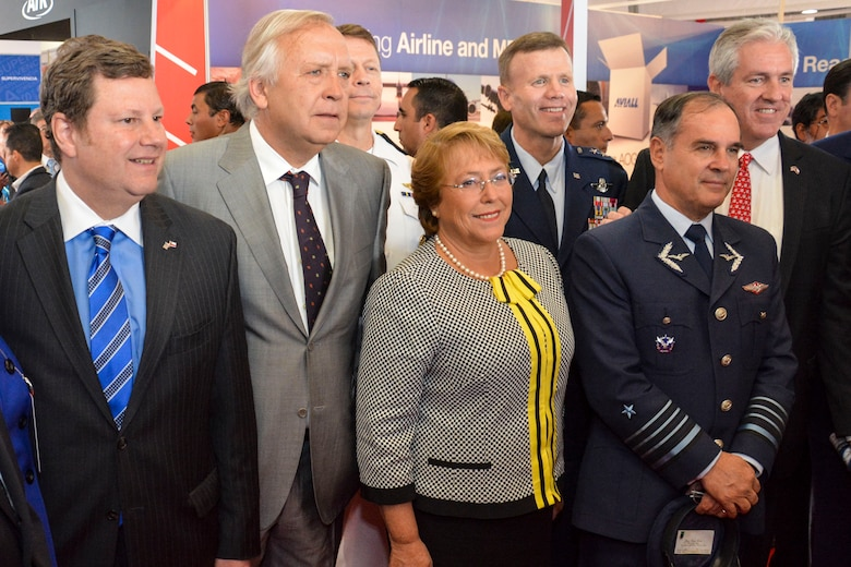 Chilean President Michelle Bachelet poses for a photo with (from left) Mr. Michael Hammer, U.S. Ambassador to Chile, Jorge Burgos, Chilean Minister of Defense, U.S. Navy Vice Adm. Joseph Rixey, director of the Defense Security Cooperation Agency, U.S. Air Force Lt. Gen. Tod Wolters, 12th Air Force (Air Forces Southern) commander, Gen. Jorge Rojas, commander-in-chief of the Chilean air force, and Tom Kallman, president and CEO of Kallman Worldwide, in the U.S. exhibition pavilion at the FIDAE Air Show in Santiago, Chile, March 25. Nearly 60 U.S. airmen are participating in subject matter expert exchanges with Chilean air force counterparts during FIDAE, and as part of the events will host static displays of the C-130 Hercules and F-16 Fighting Falcon. The exchanges, conducted regularly throughout the year, involve U.S. Airmen sharing best practices and procedures to build partnerships and promote interoperability with partner-nations throughout South America, Central America and the Caribbean. (U.S. Air Force photo by Capt. Justin Brockhoff/Released)