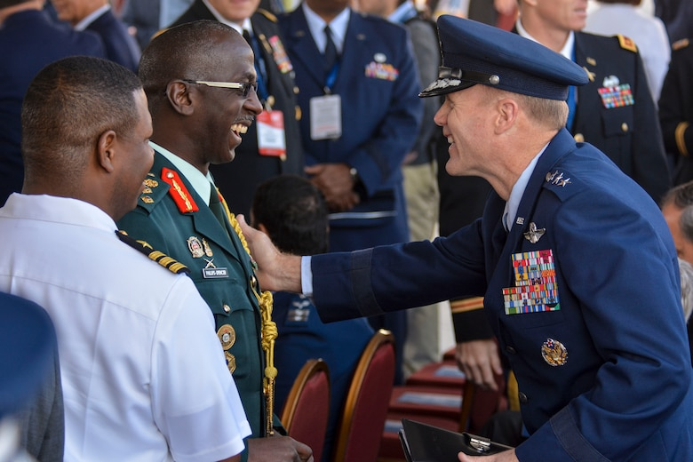 Lt. Gen. Tod Wolters, 12th Air Force (Air Forces Southern) commander, greets Brig. Gen. Anthony Phillips-Spencer, vice chief of Defence Staff of the Trinidad and Tobago Defence Force, just before the FIDAE Air Show opening ceremony in Santiago, Chile, March 25. Nearly 60 U.S. airmen are participating in subject matter expert exchanges with Chilean air force counterparts during FIDAE, and as part of the events will host static displays of the C-130 Hercules and F-16 Fighting Falcon. The exchanges, conducted regularly throughout the year, involve U.S. Airmen sharing best practices and procedures to build partnerships and promote interoperability with partner-nations throughout South America, Central America and the Caribbean. (U.S. Air Force photo by Capt. Justin Brockhoff/Released)