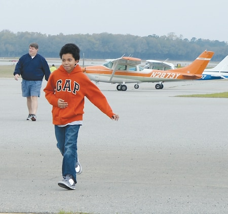 A happy child returns to a hanger after his flight compliments of the Civil Air Patrol at Southwest Georgia Regional Airport in Albany Ga., Saturday.