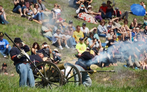 Reenactment troops and audience members enjoy another round of cannon fire during the Civil War reenactment weekend at the U.S. Army Corps of Engineers Sacramento District's Stanislaus River Parks in Knights Ferry, Calif., March 22, 2014.