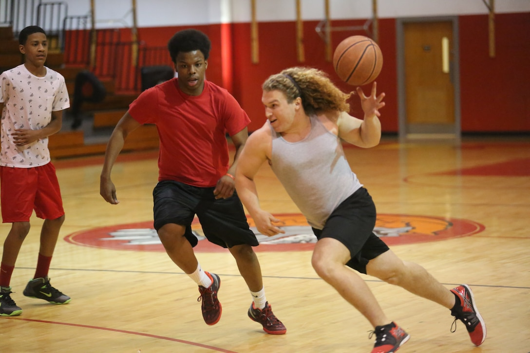 Stephen DiCenso, a student at Lejeune High School, drives the ball to the hoop for the Lejeune Lakers during the Lejeune March Madness basketball tournament at Lejeune High School, March 21. The Lejeune Lakers were defeated by the Lejeune Clippers 61-50.
