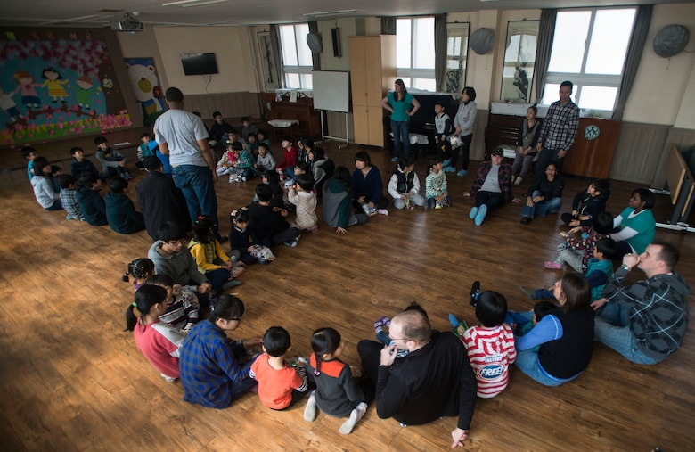 Airmen from the 51st Fighter Wing Staff Agencies at Osan Air Base, Republic of Korea, play duck, duck, goose with orphans March 22, 2014, at the Aehyang Child Welfare Center in Pyeongtaek. Airmen from Osan AB routinely volunteer at the orphanage. (U.S. Air Force photo by Staff Sgt. Jake Barreiro)
