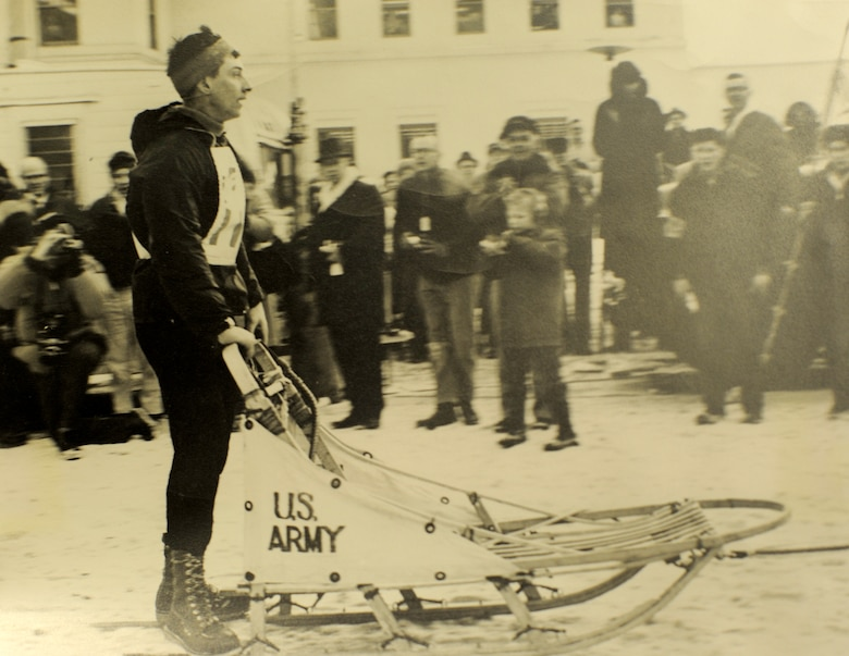 Joe Redington Jr., seen here, was enlisted specifically by the Army to race dogs in Alaska. Redington Jr. won the coveted Fur Rondy trophy in 1966, bringing it back to Alaska after many years of being won by Dr. Roland Lombard of Wayland, Mass. (U.S. Army photo)