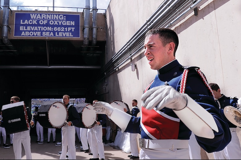 Cadet 1st Class Ford Carty, shown here performing with the Drum and Bugle Corps at the Academy, won a research award for best undergraduate research poster from the American Chemical Society's Division of Polymer Chemistry this month. (U.S. Air Force Photo/Mike Kaplan)