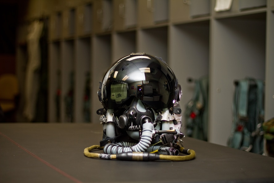 A U.S. Air Force F-16 Fighting Falcon pilot's helmet with the Helmet Mounted Integrated Targeting (HMIT) system installed sits ready before a flight in the aircrew flight equipment shop of the New Jersey Air National Guard's 177th Fighter Wing on March 25, 2014. The HMIT is a force multiplier, with a cueing system that allows rapid target acquisition, giving aircrew the ability to acquire targets by looking at them. HMIT is also compatible with existing night vision devices, and supports night operations while retaining full color displays via a high resolution device in front of the pilot's eye. (U.S. Air National Guard photo by Tech. Sgt. Matt Hecht/Released)