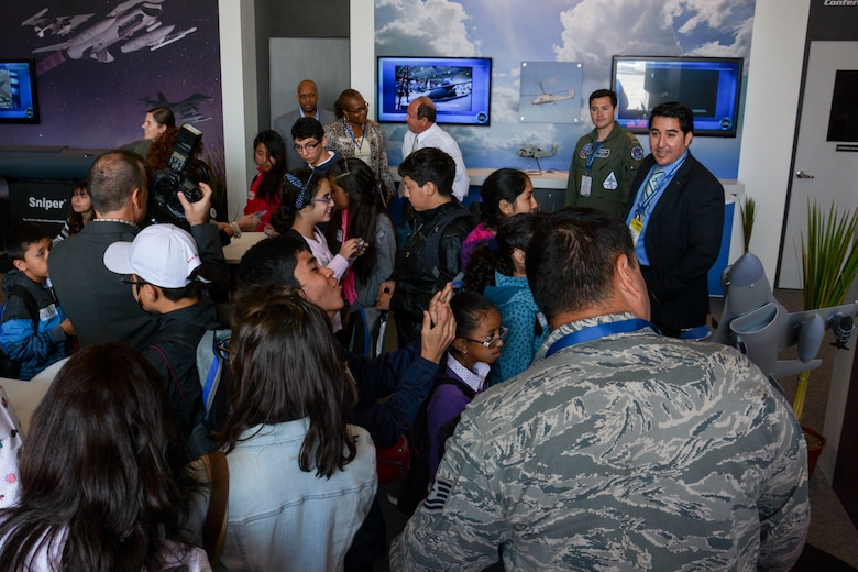 Chilean children from the Make-A-Wish and Telet?n Foundations get a tour of the U.S. pavilion at the FIDAE Air Show in Santiago, Chile, March 26. Nearly 60 U.S. airmen are participating in subject matter expert exchanges with Chilean air force counterparts during FIDAE, and as part of the events are hosting static displays of the C-130 Hercules and F-16 Fighting Falcon. Airmen from the Texas Air National Guard set aside time to host the children before the public days of FIDAE, which are scheduled for the weekend. (U.S. Air Force photo by Capt. Justin Brockhoff/Released)