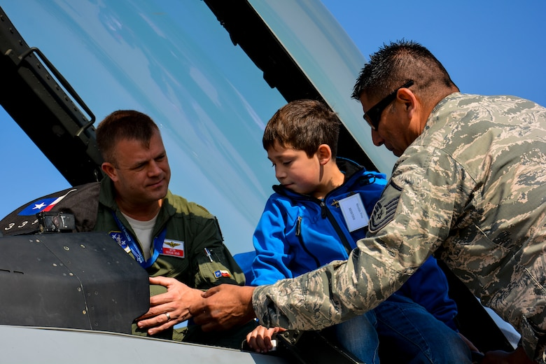 A Chilean boy from the Telet?n Foundation gets an up-close view inside a U.S. F-16 Fighting Falcon and discusses the aircraft with Maj. Scott Elrod, an F-16 pilot, and Master Sgt. Carlos Rodriguez, an F-16 maintenance specialist, at the FIDAE Air Show in Santiago, Chile, March 26. Nearly 60 U.S. airmen are participating in subject matter expert exchanges with Chilean air force counterparts during FIDAE, and as part of the events are hosting static displays of the C-130 Hercules and F-16. Airmen from the Texas Air National Guard set aside time to host the children before the public days of FIDAE, which are scheduled for the weekend. (U.S. Air Force photo by Capt. Justin Brockhoff/Released)