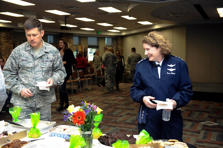 Lt. Gen. Susan Helms, former 14th Air Force, Air Force Space Command, Joint Functional Component Command for Space and U.S. Strategic Command commander, selects from a wide variety of treats during a dessert social March 21, 2014, at the Air Reserve Personnel Center conference room on Buckley Air Force Base, Colo. Helms visited Buckley in honor of Women's History Month to speak on the importance of having a positive attitude and the power of women believing in themselves. (U.S. Air Force photo by Airman 1st Class Samantha Saulsbury/Released)