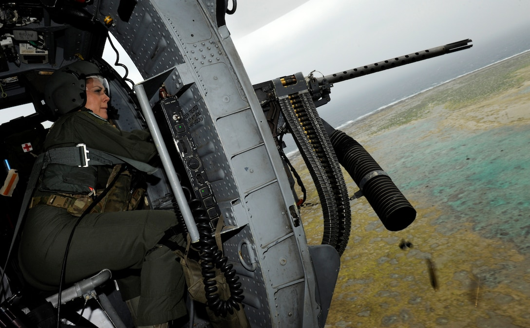 Tech. Sgt. Jewel Steamer fires a .50-caliber machinegun from an HH-60G Pave Hawk helicopter during a training flight March 20, 2014, near Okinawa, Japan. The Air Force has used Pave Hawks in an array of search and rescue missions ranging from combat operations in Iraq and Afghanistan, to Hurricane Katrina relief and Operation Tomodachi in Japan. Steamer is a 33rd Rescue Squadron flight engineer. (U.S. Air Force photo/Senior Airman Maeson L. Elleman)