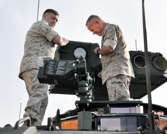 Maj. Gen. Lawrence Nicholson (right), commanding general of 1st Marine Division, Camp Pendleton, Calif., and Gunnery Sgt. Thomas Jensen, Marine Corps Forces Pacific, inspect the anti-tank weapon system of a Light Armored Vehicle Anti-Tank prototype between developmental tests at the Amphibious Vehicle Test Branch. LAV-ATs are in the midst of developmental tests as part of their modernization program at various sites throughout the country.