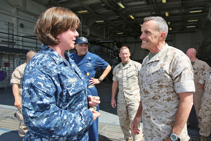 Brigadier Gen. Vincent A. Coglianese, commanding general, 1st Marine Logistics Group, speaks to Lieutenant Cmdr. Jennifer L. Forbes, executive officer of amphibious transport dock ship USS Anchorage (LPD 23), March 20, 2014. Anchorage, with embarked Marines from 1st Marine Expeditionary Force, was off the coast of California conducting amphibious warfare certification training. The Marines will conduct aircraft landing operations, live-fire training, martial arts and other drills in order to maintain their position as an expeditionary force in readiness.