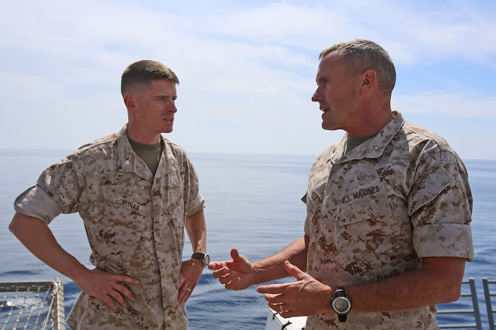 Lieutenant Col. Mark T. Donar, commanding officer, 1st Maintenance Battalion, 1st Marine Expeditionary Force, discusses his unit's expeditionary capabilities with Brig. Gen. Vincent A. Coglianese, commanding general, 1st Marine Logistics Group, aboard the amphibious transport dock ship USS Anchorage (LPD 23), March 20, 2014. Anchorage, with embarked Marines from 1st MEF, was off the coast of California conducting amphibious warfare certification training. The Marines will conduct aircraft landing operations, live-fire training, martial arts and other drills to in order to maintain their position as an expeditionary force in readiness.