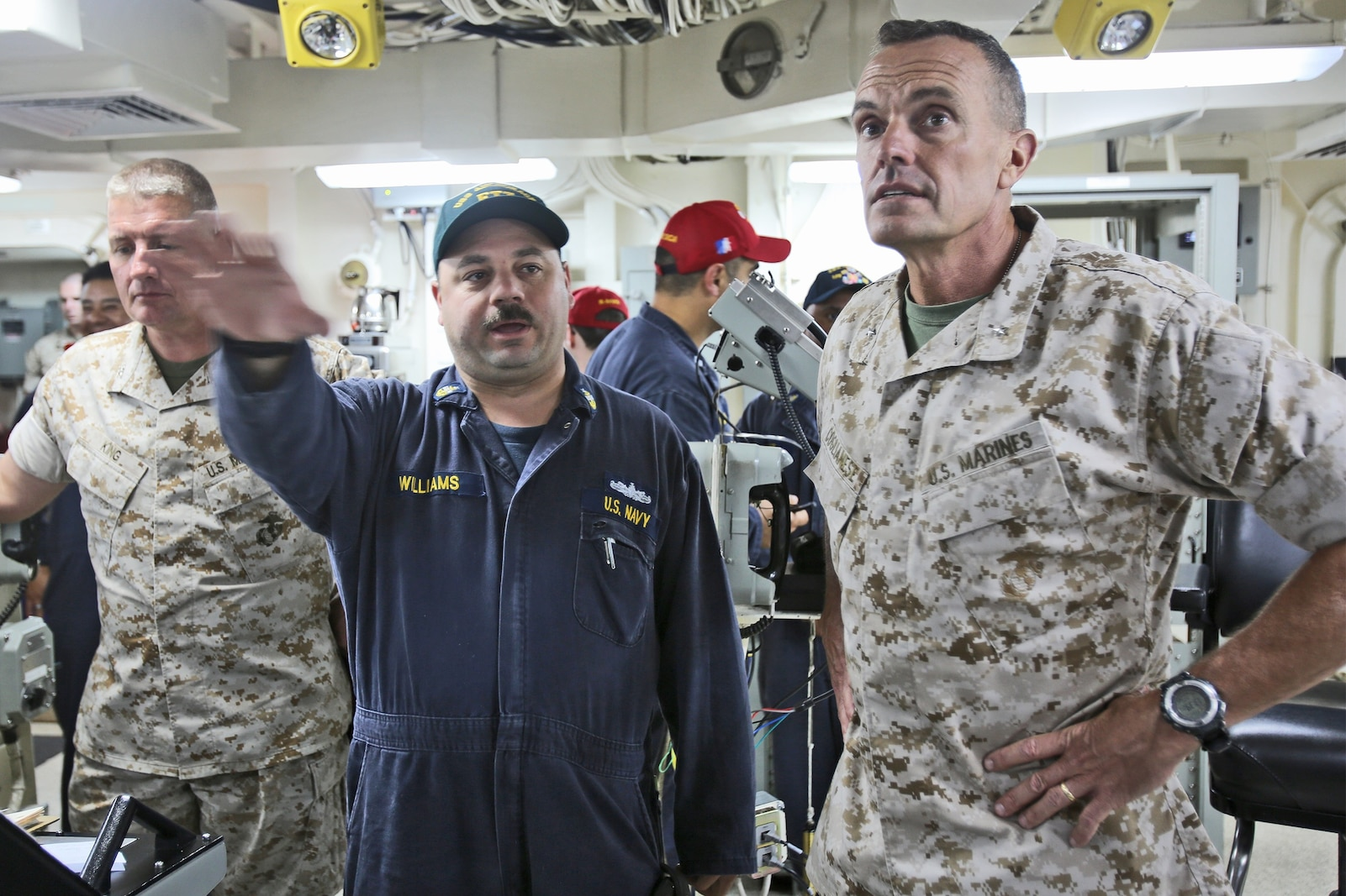 Brigadier Gen. Vincent A. Coglianese, right, commanding general, 1st Marine Logistics Group, speaks to Senior Chief Electrician's Mate Glenn Williams, aboard amphibious transport dock ship USS Anchorage (LPD 23), regarding the ship's navigation systems, March 20, 2014. The USS Anchorage, with embarked Marines from 1st Marine Expeditionary Force, was off the coast of California conducting amphibious warfare certification training. The embarked Marines will conduct aircraft landing operations, live-fire training, martial arts and other drills in order to maintain their position as an expeditionary force in readiness.