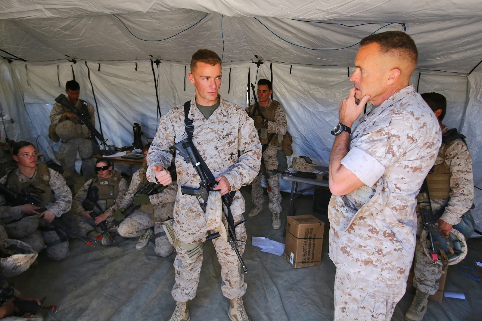 First Lt. Daniel English, company commander, Headquarters and Support Company, Combat Logistics Battalion 1, Combat Logistics Regiment 1, 1st Marine Logistics Group, talks with Brig. Gen. Vincent A. Coglianese, commanding general, 1st MLG, during Integrated Training Exercise 3-14 aboard Marine Corps Air Ground Combat Center Twenty-nine Palms, Calif., March 21, 2014. The month-long ITX prepares the battalion for its role, as the logistics combat element, in the final combat deployment of Operation Enduring Freedom.