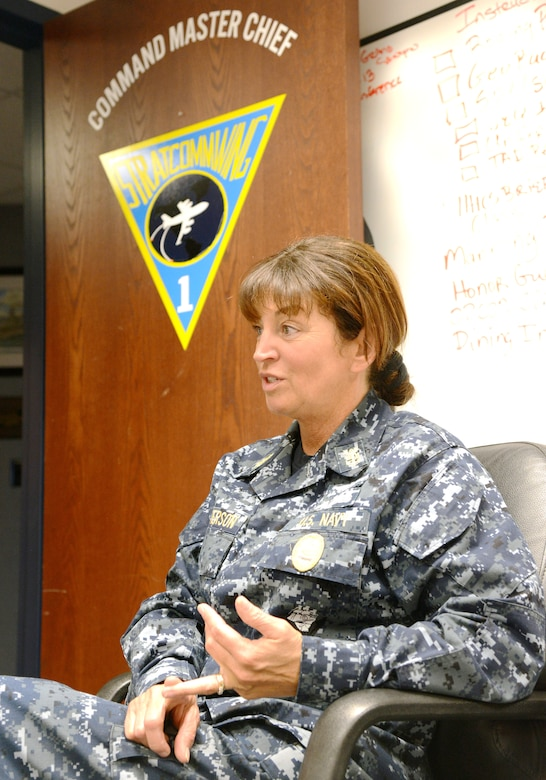 Strategic Communications Wing One Command Master Chief Cynthia Patterson reminisces about the differences in women's roles from being in the Navy now compared to when she enlisted in 1985. She cites that she would not be where she is today without support from her family and the help of numerous mentors along the way. (Air Force photo by Kelly White)