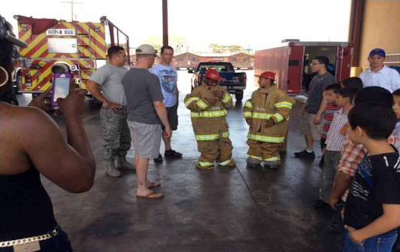 The San Antonio Padua Boys Home enjoyed a day at Soto Cano Air Base, Honduras with the Winged Warriors of the 1-228th Aviation Regiment.  The boys visited the base fire station and learned how to put on the fire protective gear, watched a kids movie and swam at the base pool.  (Courtesy Photo)
