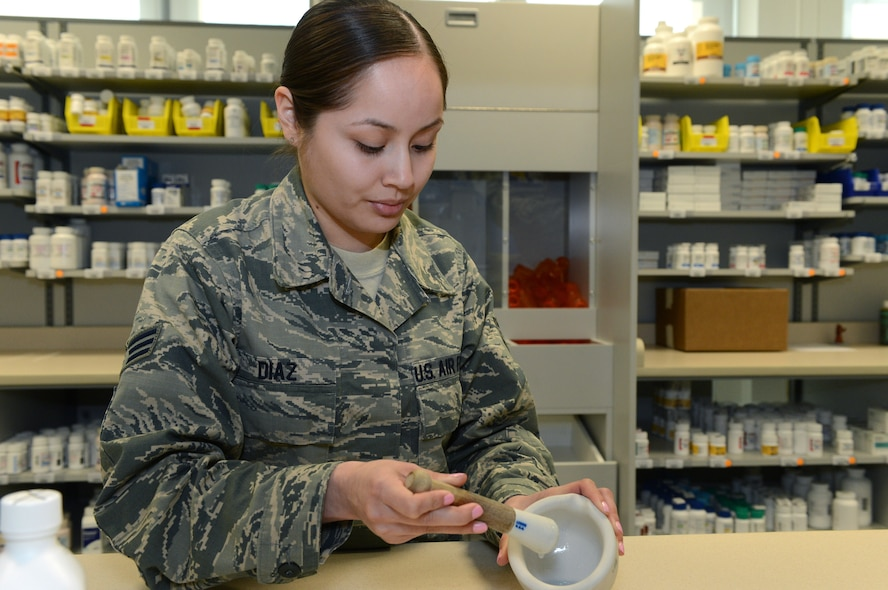 U.S. Air Force Senior Airman Venessa Diaz, 52nd Medical Support Squadron pharmacy technician from Dilley, Texas, mixes a medication at Spangdahlem Air Base, Germany, March 25, 2014. A mortar and pestle is used to crush or grind a substance into a powder and is a common practice for compounding. The pharmacy fills approximately 200 prescriptions per day and offers counseling advice for patients with questions about pharmaceuticals. (U.S. Air Force photo by Airman 1st Class Kyle Gese/Released)