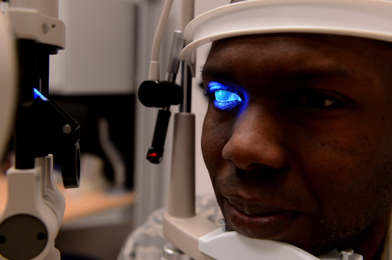 U.S. Air Force Tech Sgt. Jason Ellington, 52nd Aerospace Medicine Squadron optometry flight chief from Stuart, Fla., goes through a slit lamp test at Spangdahlem Air Base, Germany, March 25, 2014. A slit lamp test is used to detect scaring of the cornea and blood flow in the eye. (U.S. Air Force photo by Airman 1st Class Kyle Gese/Released)
