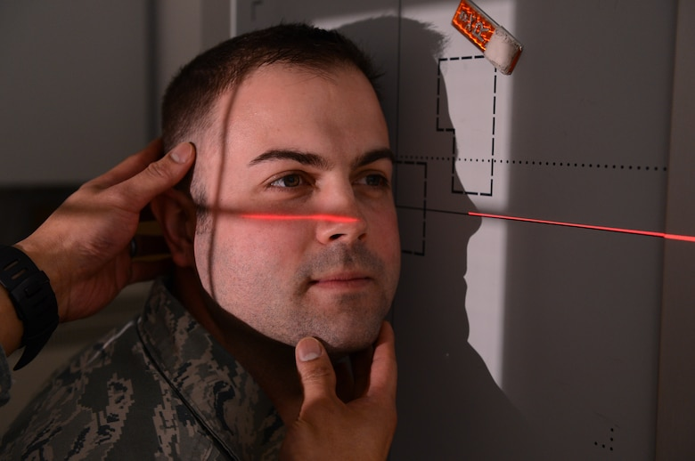 U.S. Air Force Tech Sgt. David Luce, 52nd Medical Support Squadron diagnostic imaging NCO in charge from Vacaville, Calif., positions his head for a cranium X-ray at Spangdahlem Air Base, Germany, March 25, 2014. X-rays not only can be used to identify broken bones, but also help diagnose disease and help plan treatment. In a radiographic image, lungs filled with air appear as black, fatty tissues appear as different shades of gray and bones appear whiter. (U.S. Air Force photo by Airman 1st Class Kyle Gese/Released)