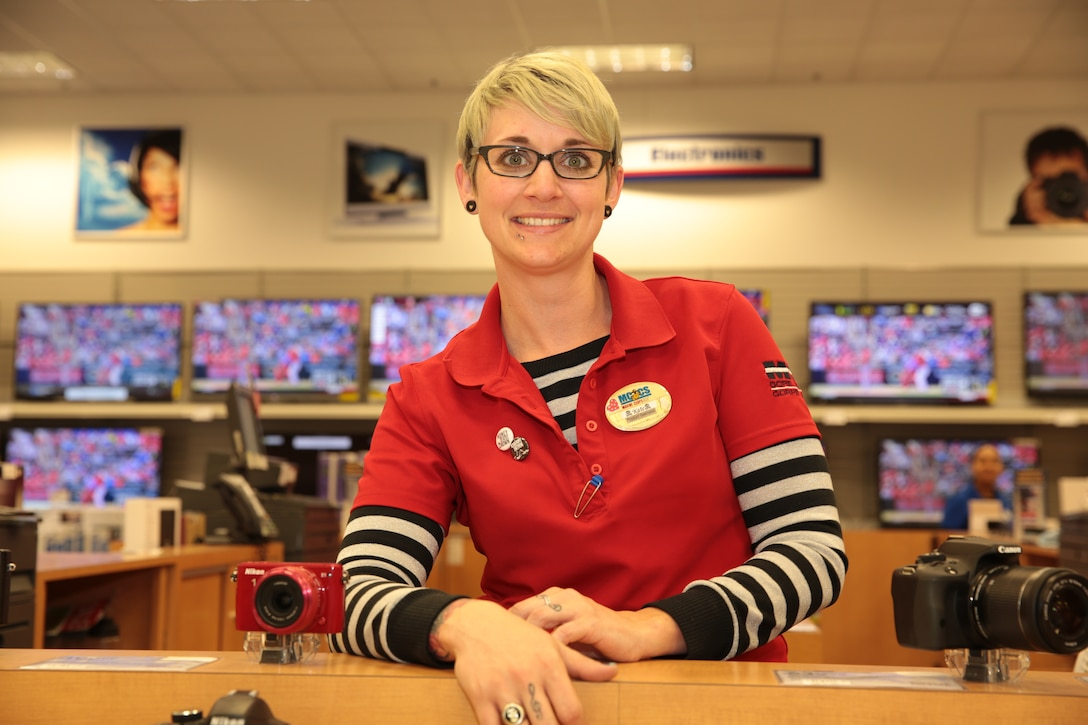Katie Walker, known as the face of electronics at the Combat Center Exchange, is known for her free spirit personality and love of electronics.
