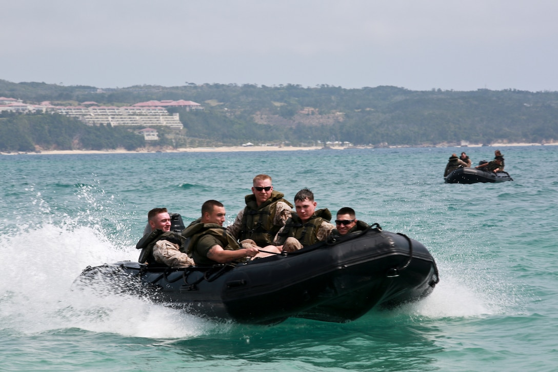 Marines maneuver Combat Rubber Raiding Craft March 19 during water-mobility training in the ocean off the Camp Schwab Beach. The CRRC are often used as safety vehicles for Bridge Erection Boats during the employment of Improved Ribbon Bridges. The Marines are combat engineers with Company A, 9th Engineer Support Battalion, 3rd Marine Logistics Group.