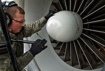 Staff Sgt. Brian Howard checks an engine on a E-3 Sentry Airborne Warning and Control System aircraft after a mission March 17, 2014, on Joint Base Elmendorf-Richardson, Alaska. Howard is assigned to the 962nd Aircraft Maintenance Unit. (U.S. Air Force photo/Justin Connaher)