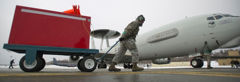 Staff Sgt. Brian Howard pulls a tool box as he prepares to perform maintenance on a E-3 Sentry Airborne Warning and Control System aircraft after a mission March 17, 2014, on Joint Base Elmendorf-Richardson, Alaska. Howard is assigned to the 962nd Aircraft Maintenance Unit. (U.S. Air Force photo/Justin Connaher)