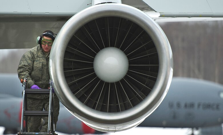 Senior Airman Kody Medrek checks an engine while performing maintenance on a E-3 Sentry Airborne Warning and Control System aircraft after a mission March 17, 2014, on Joint Base Elmendorf-Richardson, Alaska. Medrek is assigned to the 962nd Aircraft Maintenance Unit. (U.S. Air Force photo/Justin Connaher)