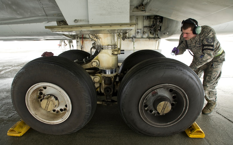 Tech Sgt. Chad McBunch inspects the landing gear on a E-3 Sentry Airborne Warning and Control System aircraft after a mission March 17, 2014, on Joint Base Elmendorf-Richardson, Alaska. McBunch is assigned to the 962nd Aircraft Maintenance Unit. (U.S. Air Force photo/Justin Connaher)