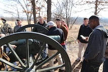Marines photograph artillery canons used in the battle of Wilson's creek.