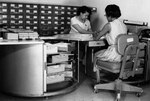 Aerial Film Control Files: Two clerks at work on aerial film control files at DIA in the 1960s.