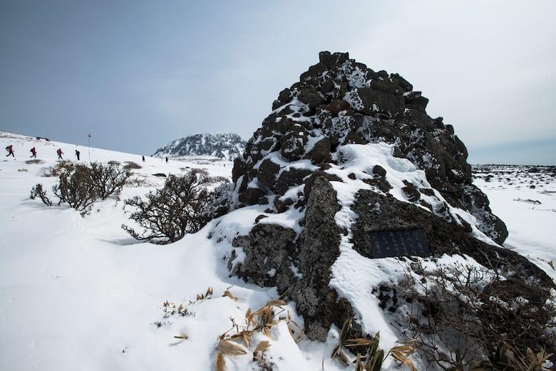 Travelers hike up Hallasan Mountain March 9, 2014, in Jeju Island, Republic of Korea. At 6,398 feet, Hallasan Mountain is the tallest mountain Korea. (U.S. Air Force photo by Staff Sgt. Jake Barreiro)