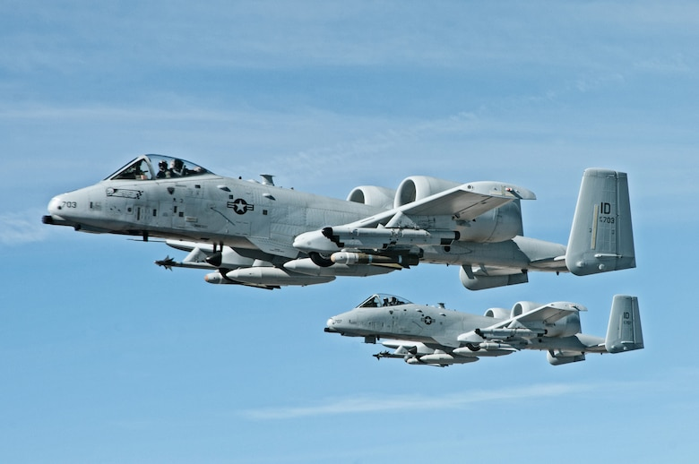 "Lt. Col. Shannon Smith, flying the lead aircraft, and 1st Lt. Bud Munns, two of Idaho Air National Guard ""Warthog"" pilots from the 190th Fighter Squadron fly the A-10 Thunderbolt II aircraft next to the Utah National Guard KC-135 Stratotanker aircraft, waiting to refuel shortly after leaving Idaho, March 9 headed to Barksdale Air Force Base, La. for the training exercise Green Flag East. (Air National Guard photo by Master Sgt. Becky Vanshur)"