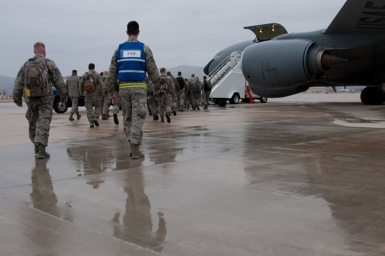 Airmen from the Idaho Air National Guard 124th Fighter Wing board the KC-135 Stratotanker aircraft headed to Barksdale Air Force Base, La. March 9 for the training exercise Green Flag East. (Air National Guard photo by Master Sgt. Becky Vanshur)